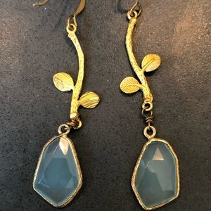Blue stone and gold earrings.